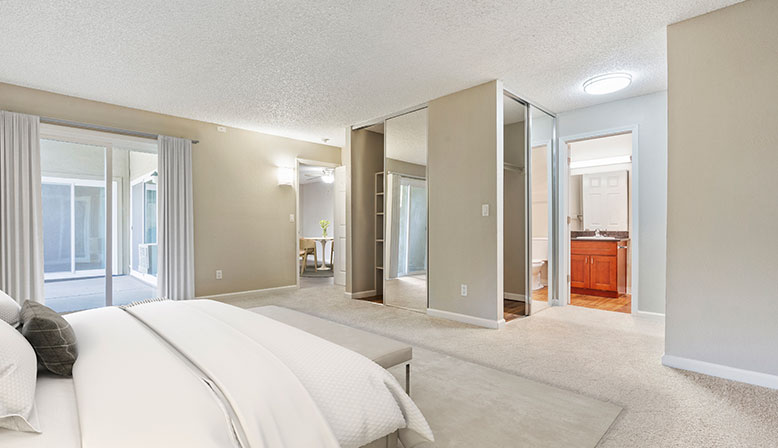 Furnished bedroom in a model unit at Rancho Luna Sol, Fremont apartments in the Bay Area
