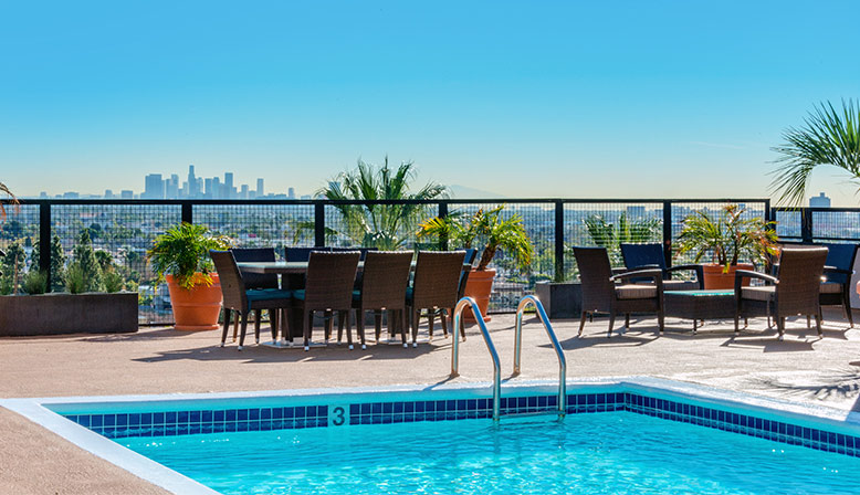Rooftop pool with daytime view of Los Angeles at West Hollywood apartments community Ascent