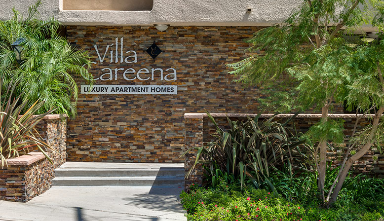 Entrance to Villa Careena, Los Angeles apartments in West Hollywood, with name on brick wall