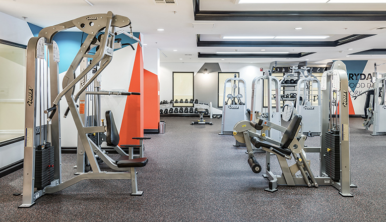 Weight machines center at Silicon Beach apartment community Playa del Oro's fitness center