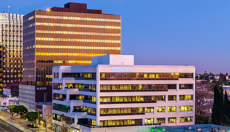 Nighttime aerial exterior of 6222 Wilshire, a Class-A Six-Story Los Angeles office building for rent
