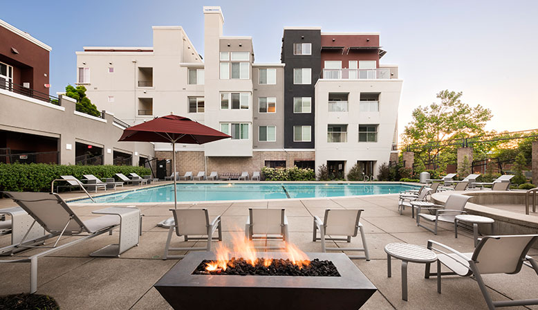 Firepit outside pool area with spa and curved pool at Bridgecourt, Emeryville apartments for rent