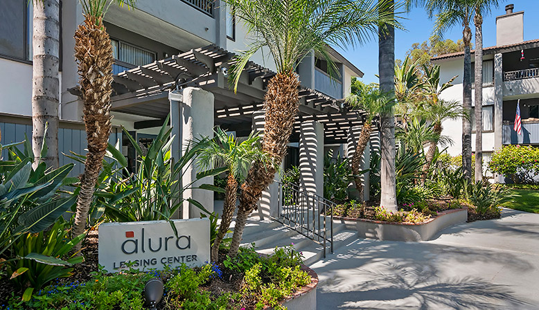 Exterior view of Woodland Hills apartments community Alura leasing center